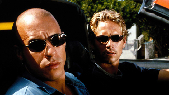 """Vin Diesel and Paul Walker in the orange Toyota Supra from """"The Fast And The Furious"""""""