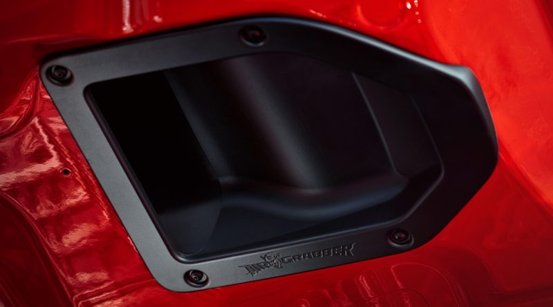 On the underside of the aluminum hood of the Dodge Challenger SR