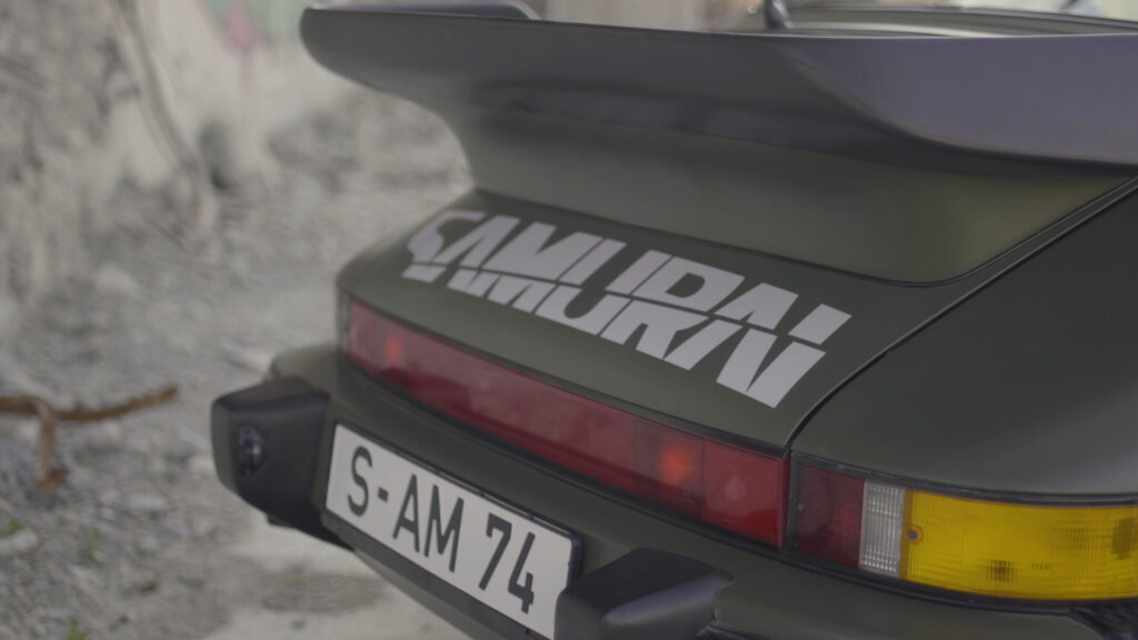 Cyberpunk 2077 real-live version of Johnny Silverhand's 1977 Porsche 911 Turbo. Rear view featuring SAMUARI decal