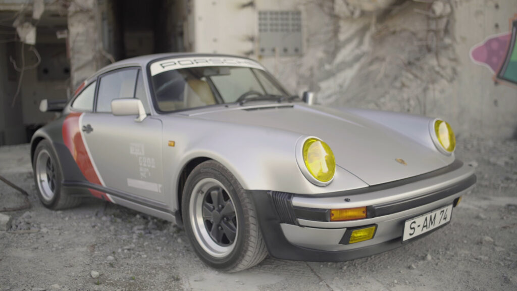 Cyberpunk 2077 real-live version of Johnny Silverhand's 1977 Porsche 911 Turbo. Front view featuring yellow headlight tint