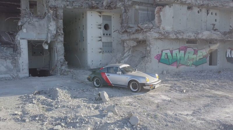 Cyberpunk 2077 real-live version of Johnny Silverhand's 1977 Porsche 911 Turbo. Elevated pulled back view