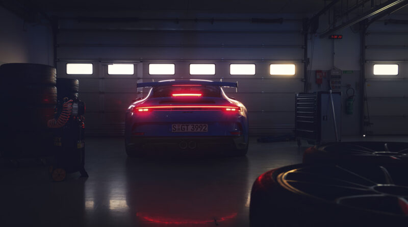 2022 Porsche 911 GT3 rear view with taillights on