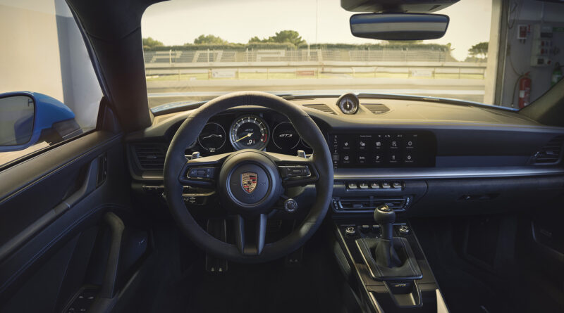 2022 Porsche 911 GT3 interior view featuring the multi-function steering wheel