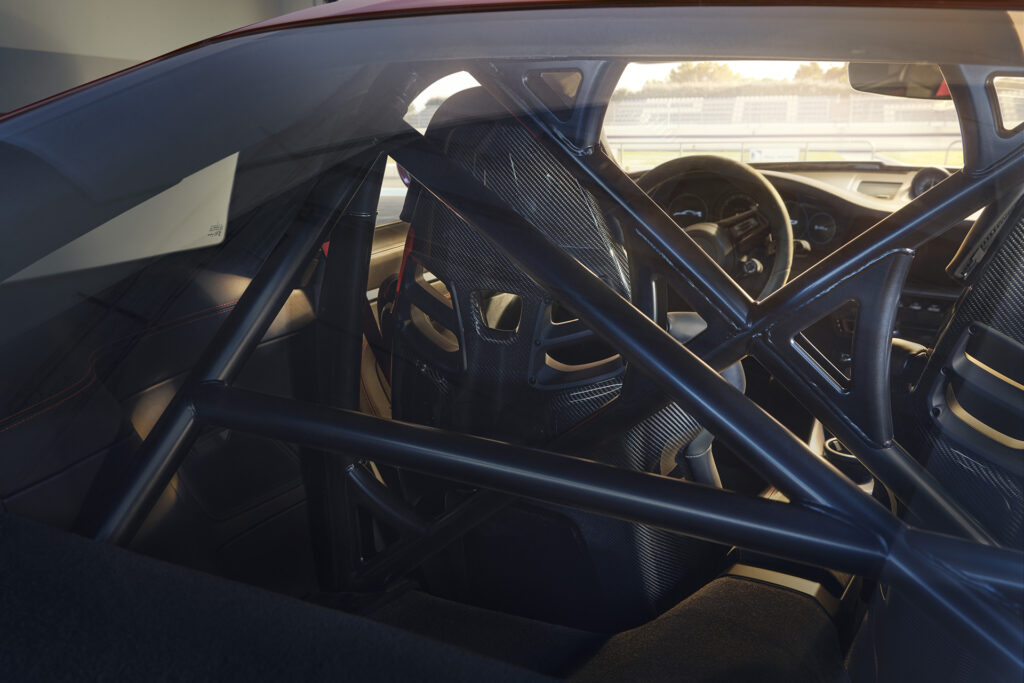 2022 Porsche 911 GT3 interior view featuring the optional rear roll cage