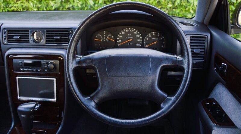 Black 1995 Nissan Gloria sedan steering wheel