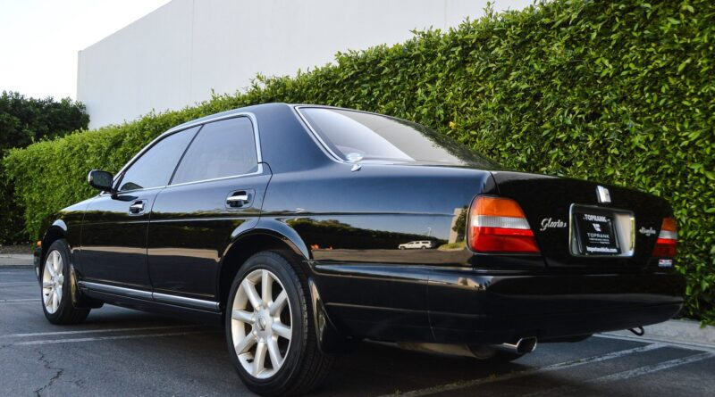 Black 1995 Nissan Gloria sedan rear quarter view