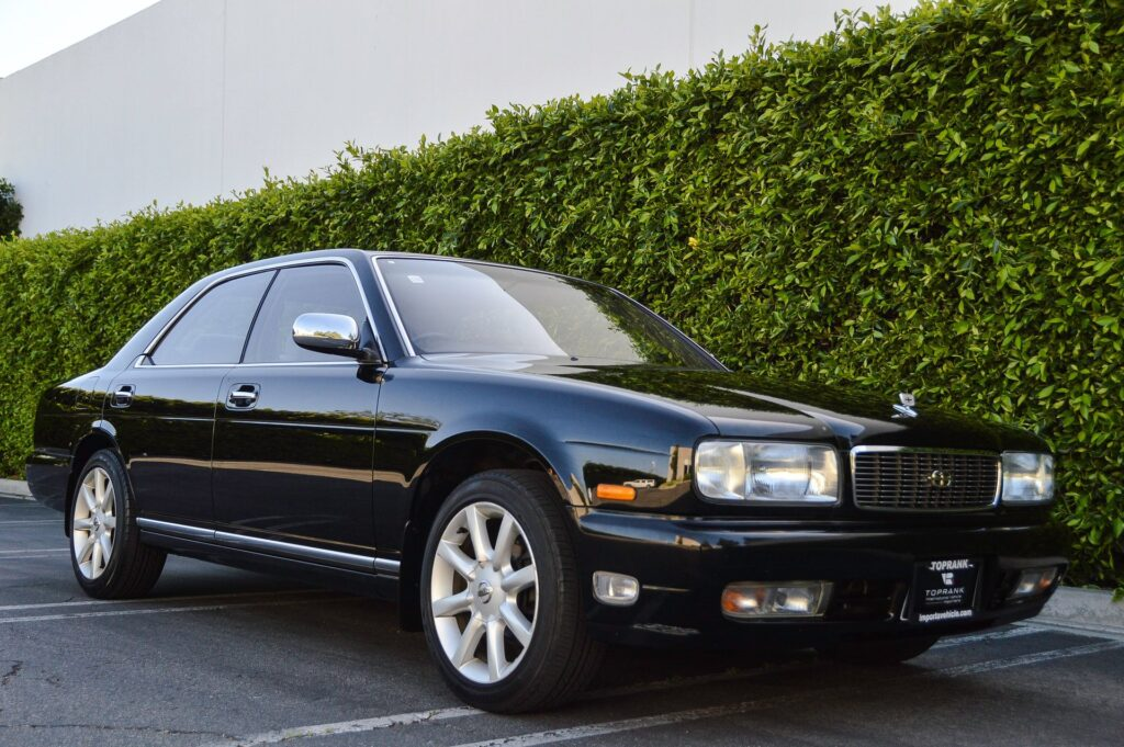 Black 1995 Nissan Gloria sedan front quarter view