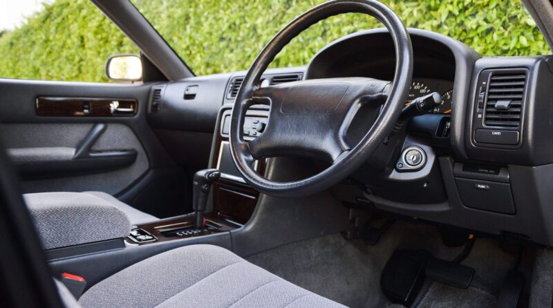 Black 1995 Nissan Gloria sedan interior right hand drive