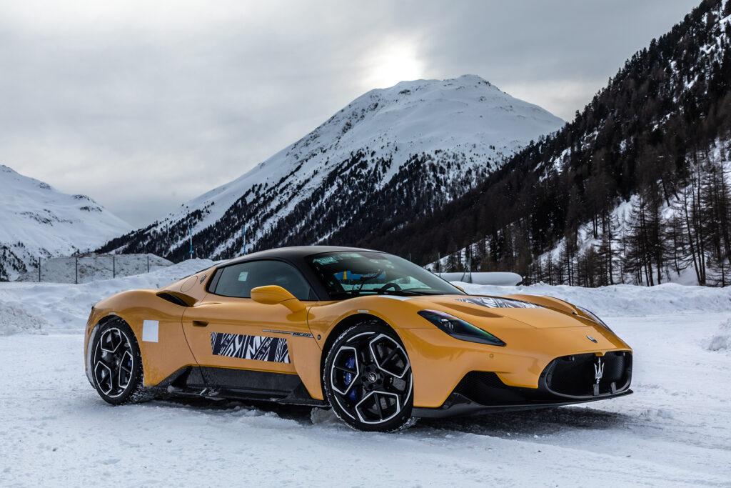 Yellow Maserati MC20 cold weather testing on a snowy track in Italy