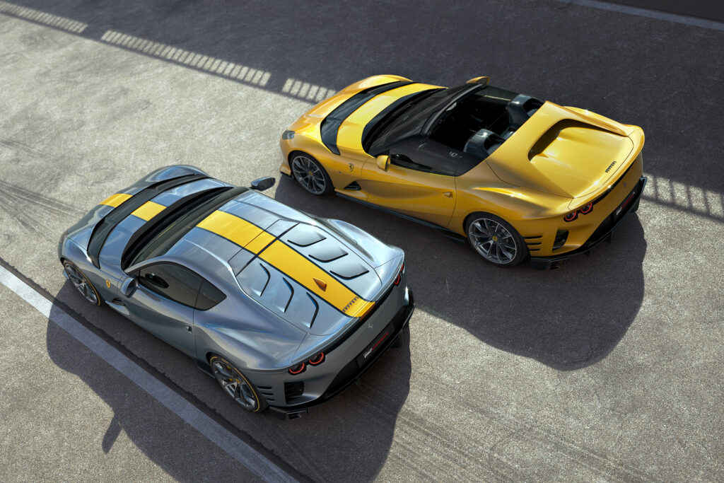 Ferrari 812 Competizione (metallic blue with yellow racing stripe) and Ferrari 812 Competizione A (yellow) parked next to each other with an overhead view