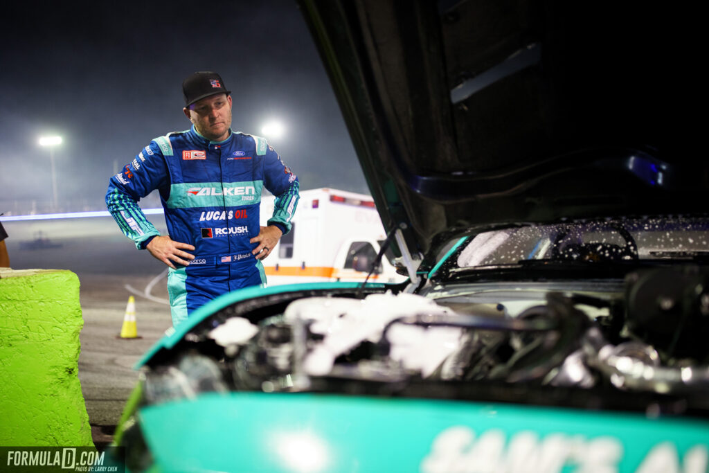Formula Drift 2021 Round 2 Orlando. Justin Pawlak looks at his fire damaged engine