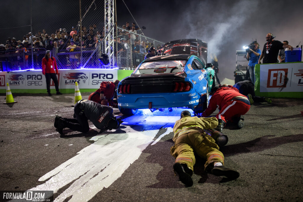 Formula Drift 2021 Round 2 Orlando. Firefighters trying to extinguish an engine fire in Justin Pawlak's Ford Mustang drift car