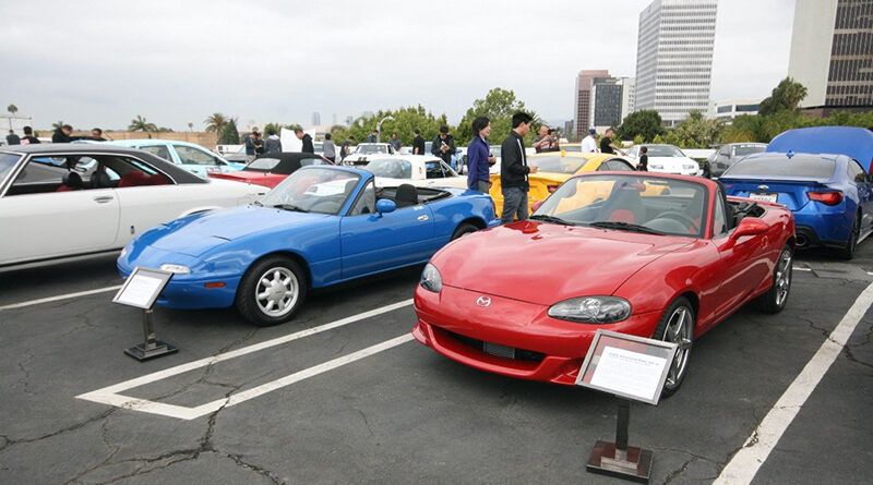 Blue (left) and red (right) Mazda MX-5 roadsters parked at the Petersen Automotive Museum's Japanese Car Cruise in