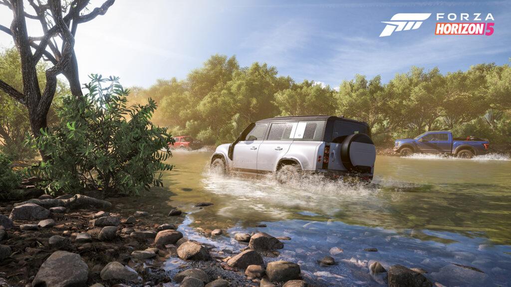 Forza Horizon 5 screenshot of a white 2021 Land Rover Defender treading through water