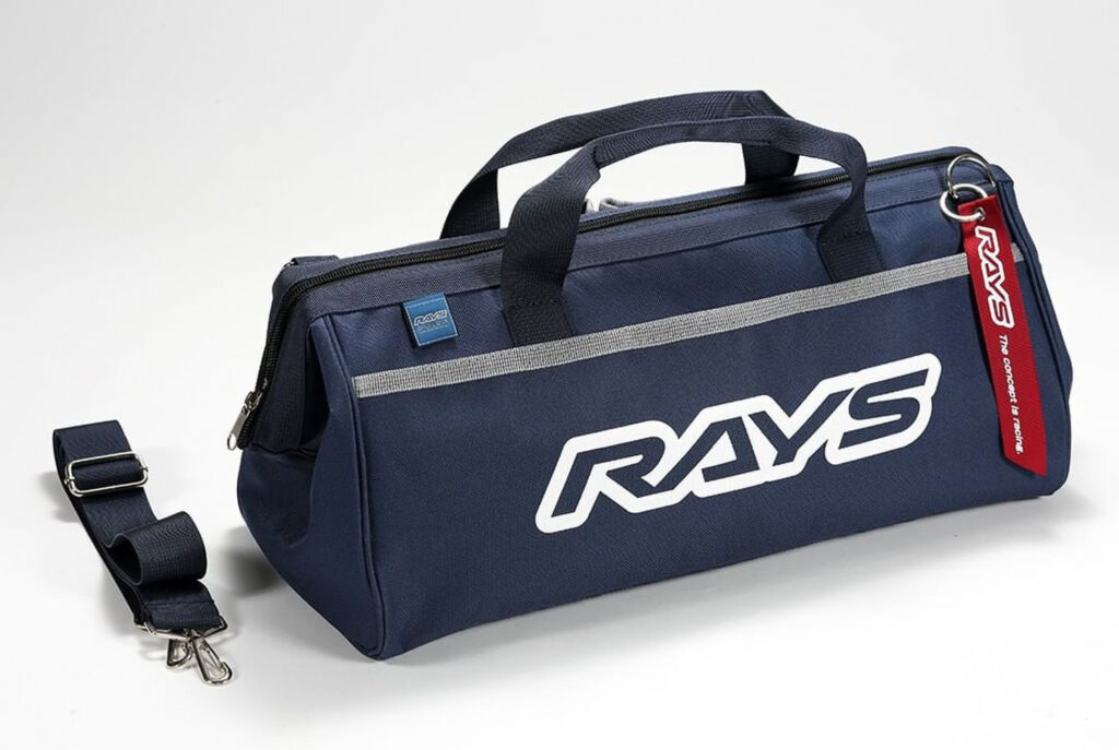 RAYS Engineering tool bag in navy blue. Shown with detachable shoulder strap and red RAYS logo jet tag
