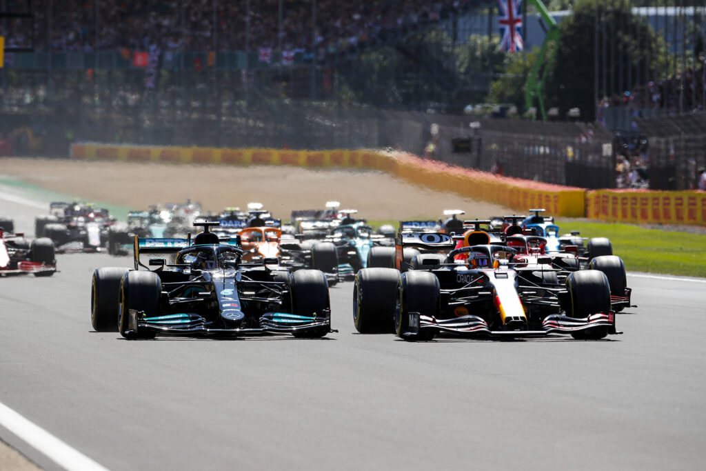 Lewis Hamilton and Max Verstappen racing side by side at the 2021 British GP. Photo provided by Daimler