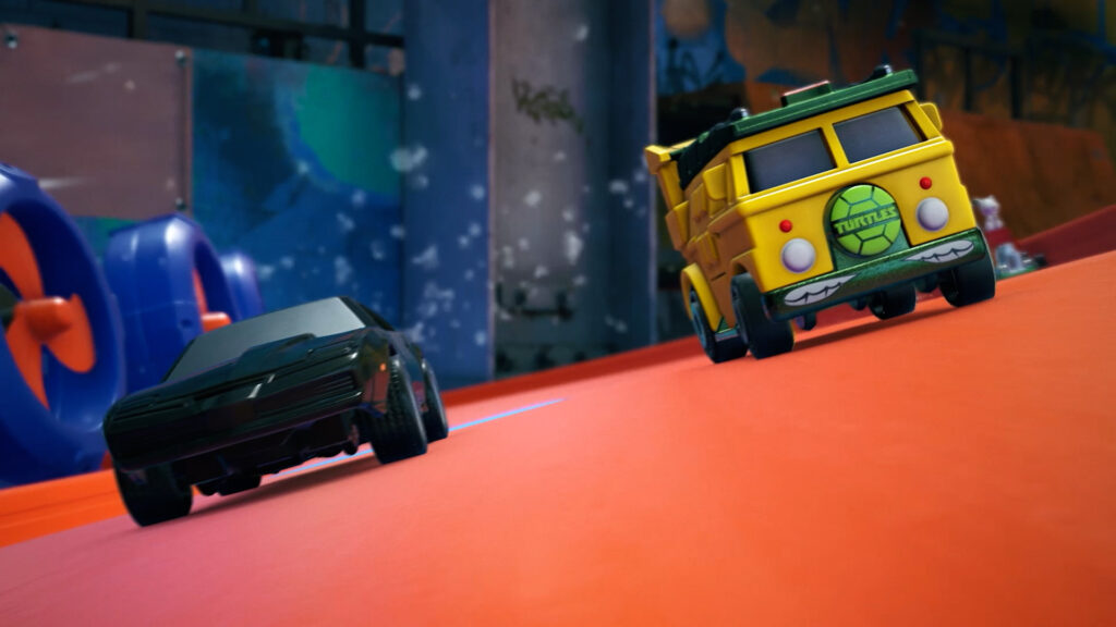 Hot Wheels Unleashed gameplay screenshot with the Teenage Mutant Ninja Turtles Party Wagon and K.I.T.T. from Knight Rider