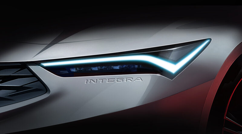 """A Teaser Image of the 2022 Acura Integra showing just the headlight with the """"Integra"""" logo embossed in the bumper just below."""