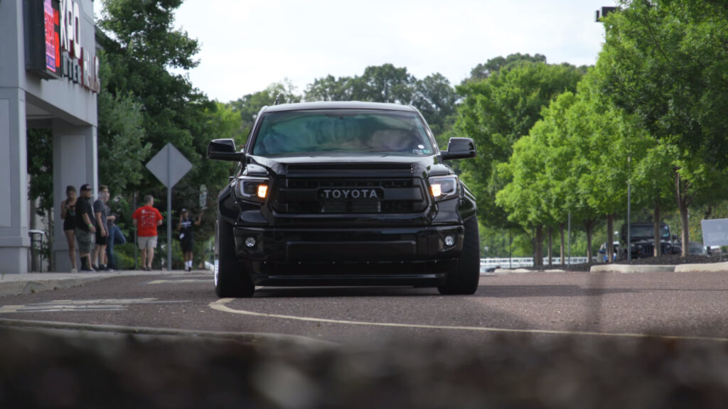 Black Toyota Tacoma truck equipped with Rocket Bunny fenders as seen at the 2021 Tuner Evolution show in Philadelphia